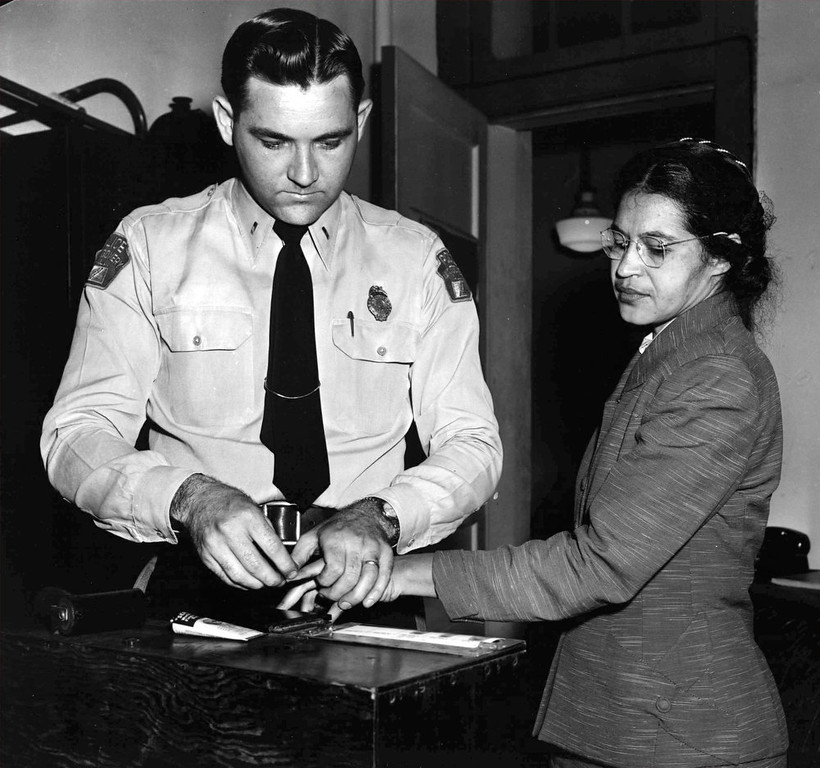 . Rosa Parks, whose refusal to move to the back of a bus touched off the Montgomery bus boycott and the beginning of the civil rights movement, is fingerprinted by police Lt. D.H. Lackey in Montgomery, Ala., Feb. 22, 1956.  She was among some 100 people charged with violating segregation laws. (AP Photo/Gene Herrick)