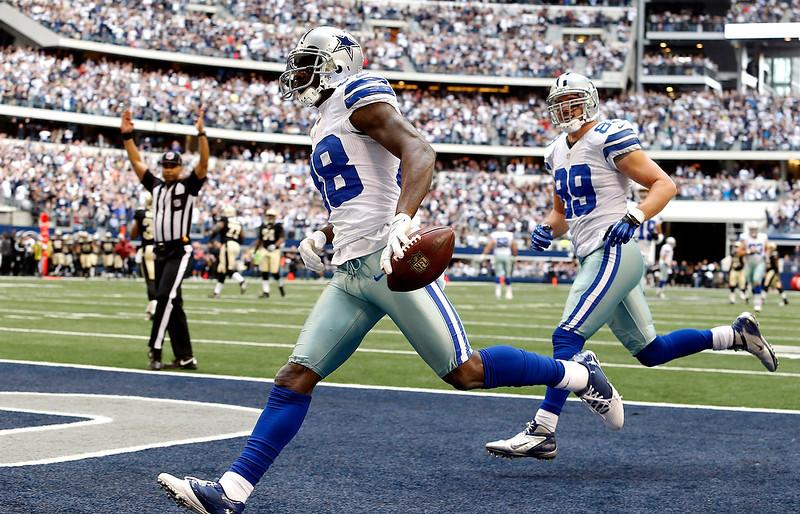 . Dallas Cowboys wide receiver Dez Bryant (88) goes in for a touchdown against the New Orleans Saints as tight end John Phillips (89) follows during the first half of an NFL football game on Sunday, Dec. 23, 2012, in Arlington, Texas. (AP Photo/Sharon Ellman)