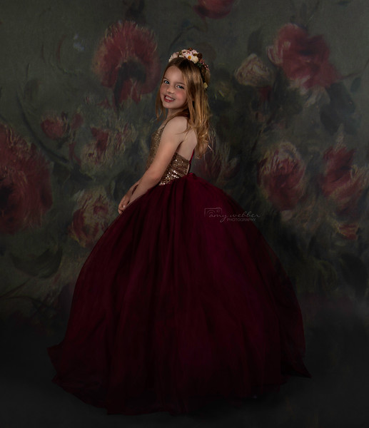 madelyn standing sideays smiling at camera with floral texture. marron gown. HIGH RES.jpg