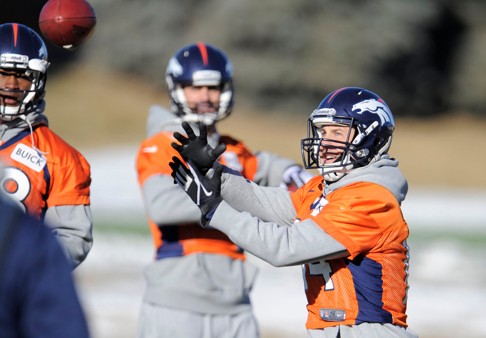 . Denver Broncos wide receiver Brandon Stokley (14) catches a pass during  practice Thursday, January 3, 2013 at Dove Valley.  John Leyba, The Denver Post