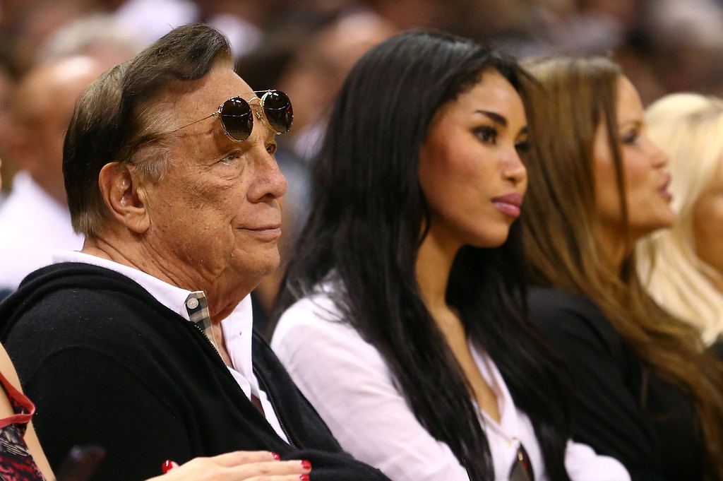 . (2nd L) Team owner Donald Sterling of the Los Angeles Clippers watches the San Antonio Spurs play against the Memphis Grizzlies during Game One of the Western Conference Finals of the 2013 NBA Playoffs at AT&T Center on May 19, 2013 in San Antonio, Texas.    (Photo by Ronald Martinez/Getty Images)