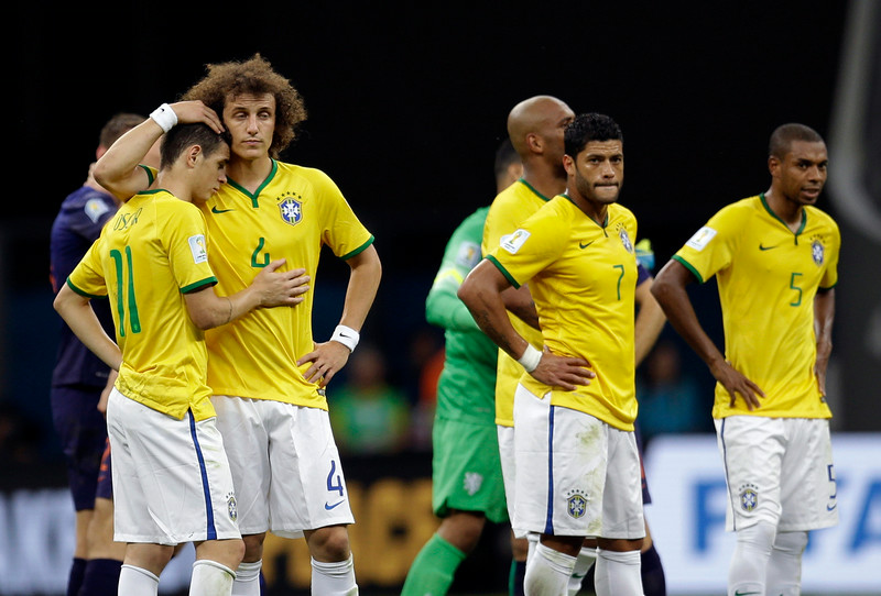 . Brazil\'s David Luiz, left, and Oscar console each other alongside Hulk, center, and Fernandinho, right, after the Netherlands 3-0 victory over Brazil in the World Cup third-place soccer match between Brazil and the Netherlands at the Estadio Nacional in Brasilia, Brazil, Saturday, July 12, 2014. (AP Photo/Natacha Pisarenko)