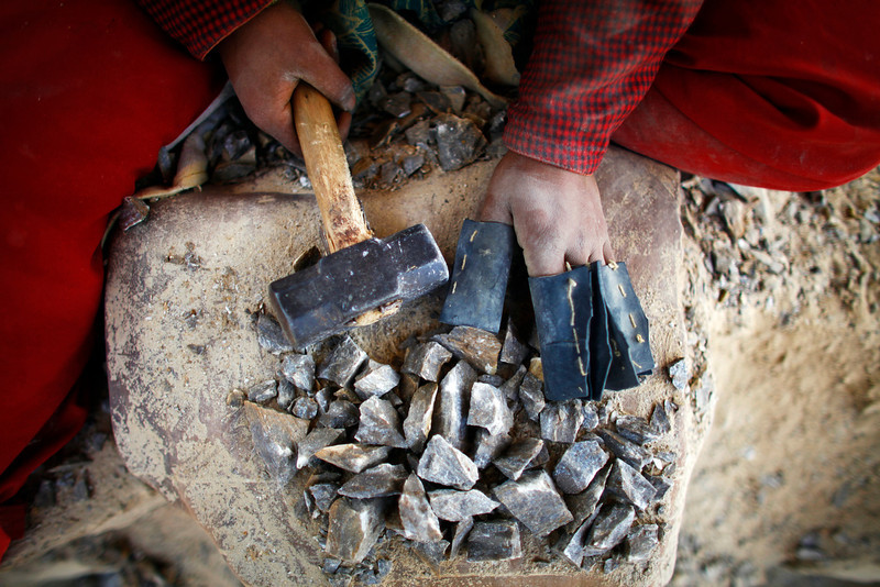. In this Friday, March 7, 2014 photo, a Nepalese woman works at a stone quarry on the eve of International Women�s Day in Katmandu, Nepal. (AP Photo/Niranjan Shrestha)