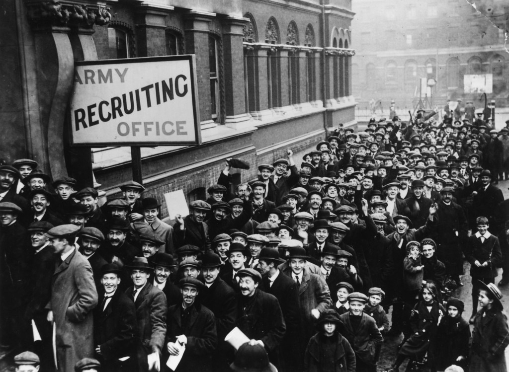 . December 1915:  A crowd of young men queuing up at the Army Recruiting Office at Southwark Hall, south London, during Lord Derby\'s recruitment campaign.  (Photo by Topical Press Agency/Getty Images)