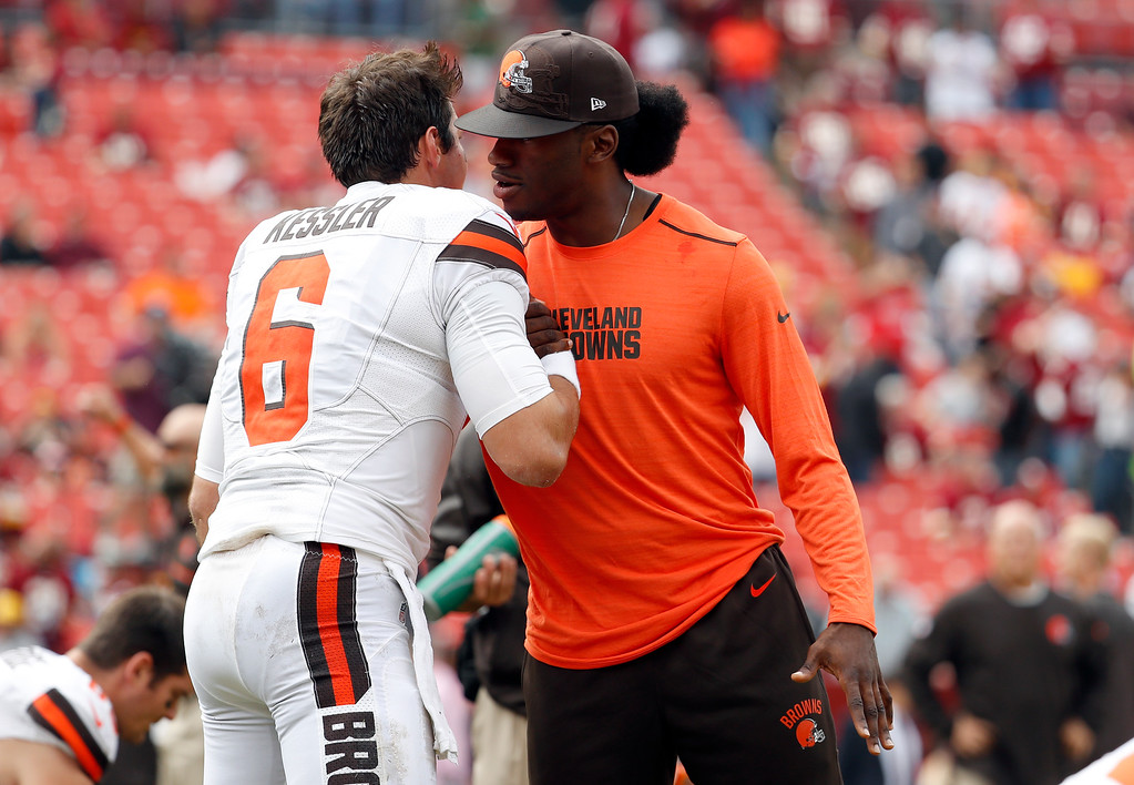 . Cleveland Browns quarterback Cody Kessler (6) reacts with injured quarterback Robert Griffin III before an NFL football game against the Washington Redskins Sunday, Oct. 2, 2016, in Landover, Md. (AP Photo/Carolyn Kaster)