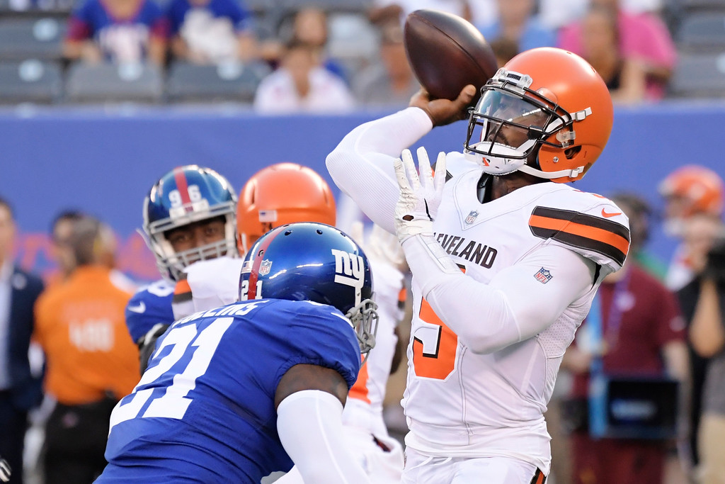 . Cleveland Browns quarterback Tyrod Taylor (5) throws a pass over New York Giants\' Landon Collins (21) during the first half of a preseason NFL football game Thursday, Aug. 9, 2018, in East Rutherford, N.J. (AP Photo/Bill Kostroun)