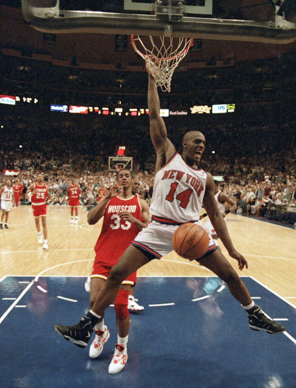 . FILE - In this June 17, 1994 New York Knicks forward Anthony Mason (14) dunks the ball ahead of Houston Rockets forward Otis Thorpe (33) during the fourth quarter of game five of the NBA Finals in New York.  The New York Knicks spokesman Jonathan Supranowitz confirmed Saturday, Feb. 28, 2015 that Mason, a rugged power forward who was a defensive force for several NBA teams in the 1990s, has died. He was 48. (AP Photo/Amy Sancetta)