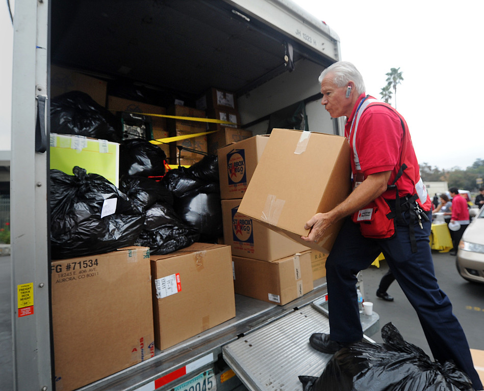 . Heinrich Keifer, a volunteer for American Red Cross, loading truck with clothing, canned goods, toiletries and non-perishable food at the Rose Bowl.  Philippine Typhoon Relief PCC along with Vice Mayor Jacque Robinson, the American Red Cross, Filipino American Television, Victory Cargo, and the PNB-Remittance Centers  sponsoring a Philippine Typhoon Relief Donation Drive Donation Drive Drop-Off Rally Wednesday, November 20, 2013. (Photo by Walt Mancini/Pasadena Star-News)