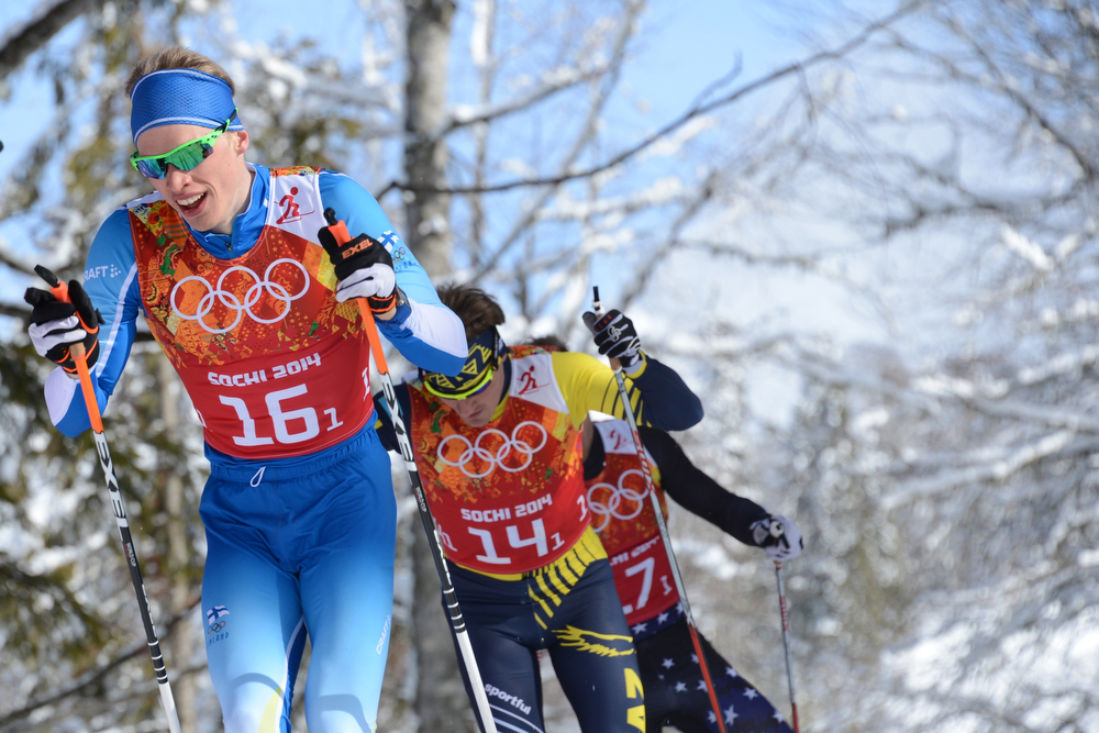 . From left to right: Finland\'s Iivo Niskanen, Kazakhstan\'s Nikolay Chebotko and US Simeon Hamilton competes in the Men\'s Cross-Country Skiing Team Sprint Classic Semifinals at the Laura Cross-Country Ski and Biathlon Center during the Sochi Winter Olympics on February 19, 2014 in Rosa Khutor near Sochi. (KIRILL KUDRYAVTSEV/AFP/Getty Images)
