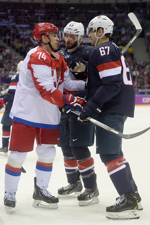 . Alexei Yemelin (74) of the Russia gets mouthy with Max Pacioretty (67) of the U.S.A. and Ryan Kesler (17) during the first period of men\'s hockey action at Bolshoy arena. Sochi 2014 Winter Olympics on Saturday, February 15, 2014. (Photo by AAron Ontiveroz/The Denver Post)