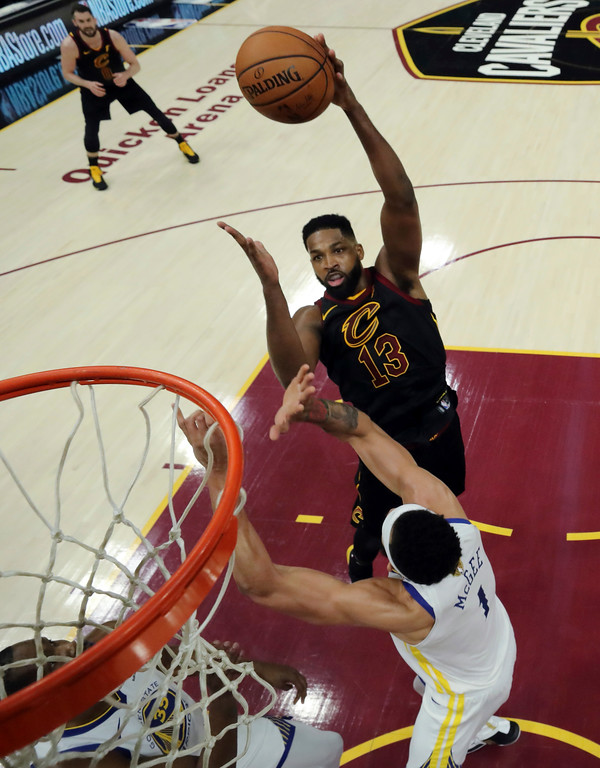 . Cleveland Cavaliers\' Tristan Thompson shoots over Golden State Warriors\' JaVale McGee during the first half of Game 3 of basketball\'s NBA Finals, Wednesday, June 6, 2018, in Cleveland. (Gregory Shamus/Pool Photo via AP)