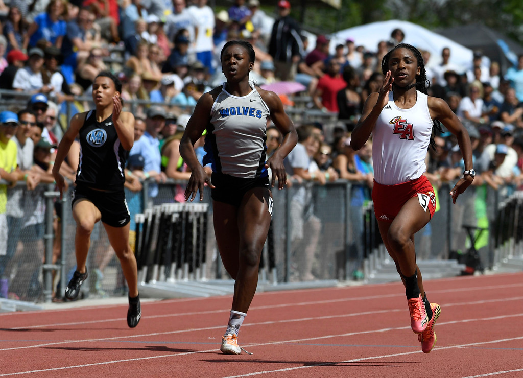 . Arria Minor, Denver East, right, edges out Michaela Onyenwere, Grandview, during the girls 5A 100 meter final at the Colorado Track and Field State Championships at Jeffco Stadium May 21, 2016. Minor won with a time of 11:83 (Photo by Andy Cross/The Denver Post)