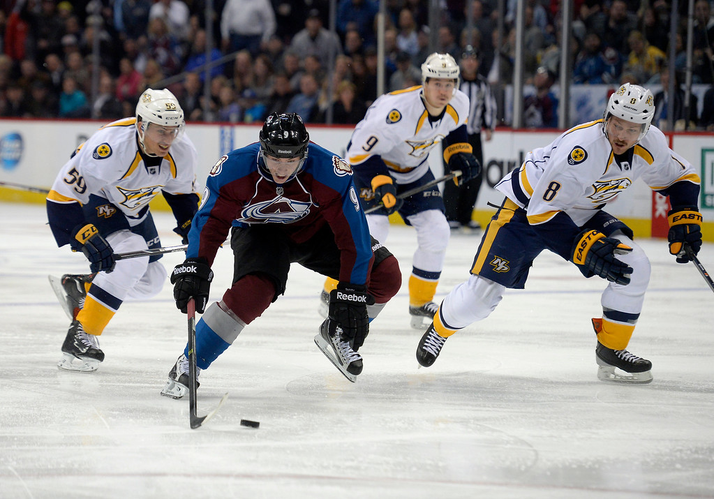 . Colorado Avalanche center Matt Duchene (9) splits defenders Nashville Predators defenseman Roman Josi (59) and Nashville Predators defenseman Kevin Klein (8) as he skates in for a shot on goal and score during the third period November 6, 2013 at Pepsi Center. Nashville Predators defeated the Colorado Avalanche 6-4. (Photo by John Leyba/The Denver Post)