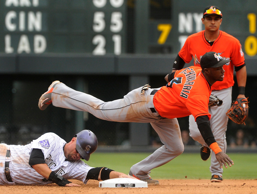 . Michael Cuddyer upended Marlins\' infielder Adeiny Hechavarria after he was forced out at second base in the fourth inning. The Colorado Rockies hosted the Miami Marlins at Coors Field Thursday afternoon, July 25, 2013. Photo By Karl Gehring/The Denver Post