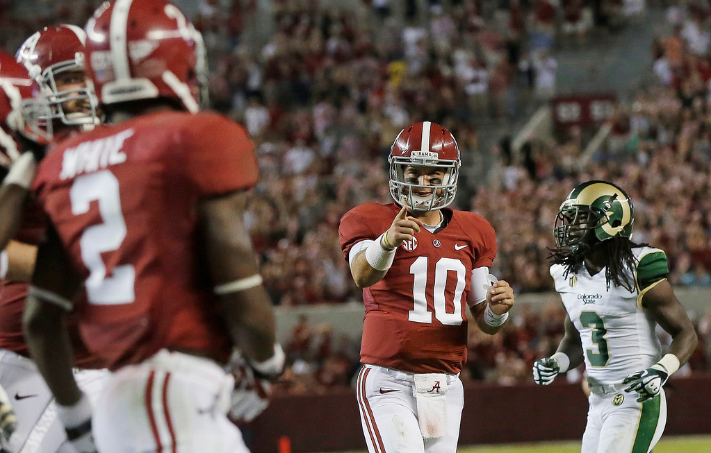 . Alabama quarterback AJ McCarron (10) celebrates after throwing a 30-yard touchdown pass to wide receiver DeAndrew White (2) during the second half of an NCAA college football game in Tuscaloosa, Ala., Saturday, Sept. 21, 2013. At right is Colorado State cornerback Shaq Bell. Alabama won31-6. (AP Photo/Dave Martin)