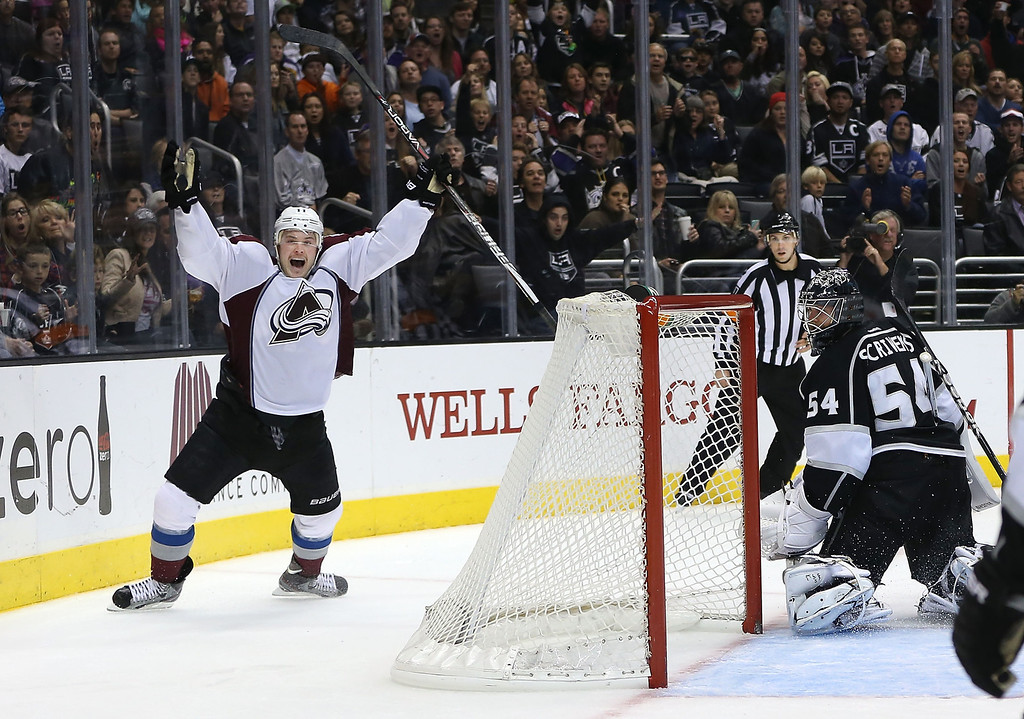 . LOS ANGELES, CA - NOVEMBER 23:  Jamie McGinn #11 of the Colorado Avalanche reacts after scoring against goaltender Ben Scrivens #54 of the Los Angeles Kings in overtime in their NHL game at Staples Center on November 23, 2013 in Los Angeles, California. The Avalanche defeated the Kings 1-0 in overtime. (Photo by Victor Decolongon/Getty Images)
