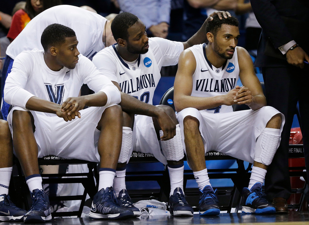 . Villanova\'s JayVaughn Pinkston (22) and Darrun Hilliard II (4) react with teammates during the second half of a third-round game in the NCAA men\'s college basketball tournament in Buffalo, N.Y., Sunday, March 23, 2014. (AP Photo/Frank Franklin II)
