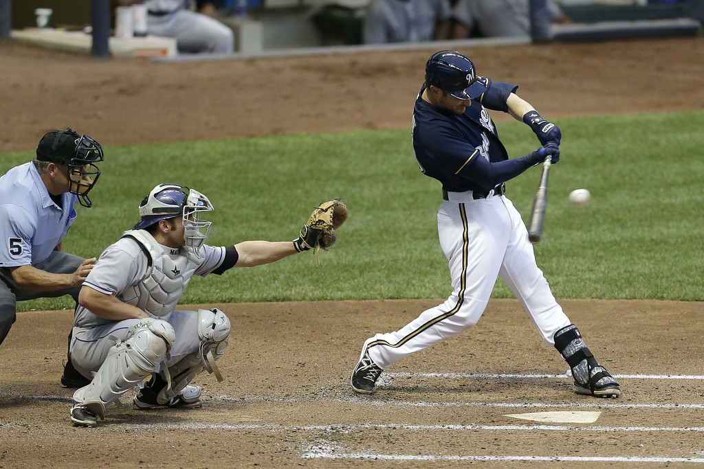 . MILWAUKEE, WI - JUNE 27: Jonathan Lucroy #20 of the Milwaukee Brewers hits a single in the bottom of the fourth inning against the Colorado Rockies at Miller Park on June 27, 2014 in Milwaukee, Wisconsin. (Photo by Mike McGinnis/Getty Images)