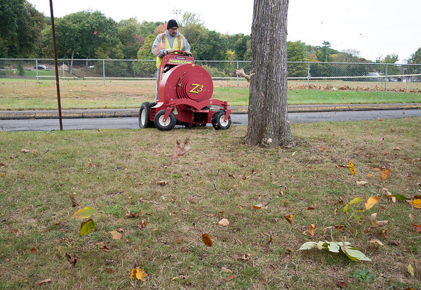 10/08/19 Wesley Bunnell | StaffrrCity employee Benny Morales uses a riding leaf blower to tidy up Stanley Quarter Park on Tuesday afternoon.