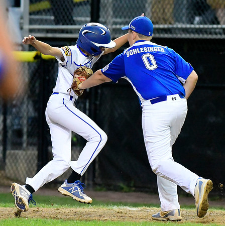 8/9/2018 Mike Orazzi | Staff Keystone Little League Levi Schlesinger (0) tags out Maryland's Foster Smith (50) at Breen Field in Bristol during Thursday evenings 2018 Eastern Regional Little League Baseball Tournament.