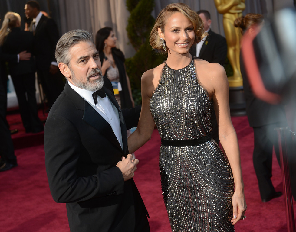 . Actor George Clooney, left, and Stacy Keibler arrives at the 85th Academy Awards at the Dolby Theatre in Los Angeles, California on Sunday Feb. 24, 2013 ( Hans Gutknecht, staff photographer)