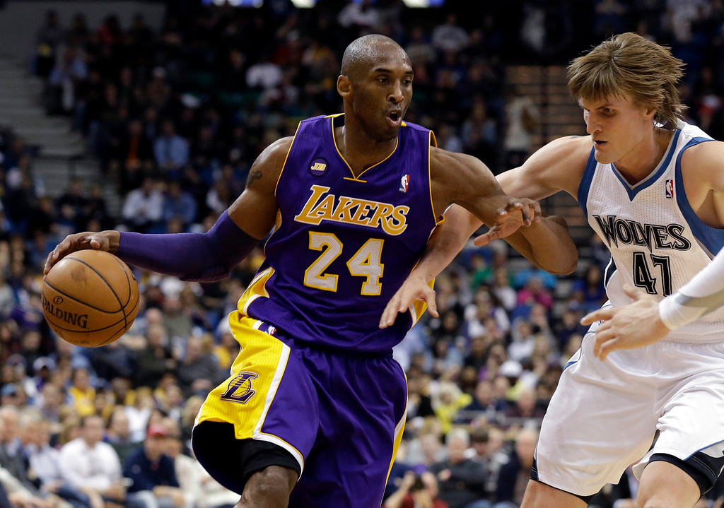 . Los Angeles Lakers\' Kobe Bryant, left, drives past Minnesota Timberwolves\' Andrei Kirilenko of Russia in the second half of an NBA basketball game Wednesday, March 27, 2013 in Minneapolis. Bryant led the Lakers with 31 points in their 120-117 win. (AP Photo/Jim Mone)