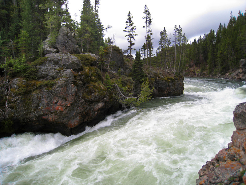 The Yellowstone River at the brink of the Upper Falls - the water is just starting to slide over the edge in the bottom left of this photo