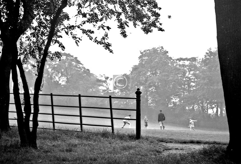Things To Do In the Queen's Park, no.13 - Have a game of, ummm, not quite sure what they were playing.