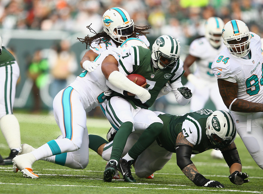 . Olivier Vernon #50 of the Miami Dolphins sacks  Geno Smith #7 of the New York Jets during their game at MetLife Stadium on December 1, 2013 in East Rutherford, New Jersey.  (Photo by Al Bello/Getty Images)