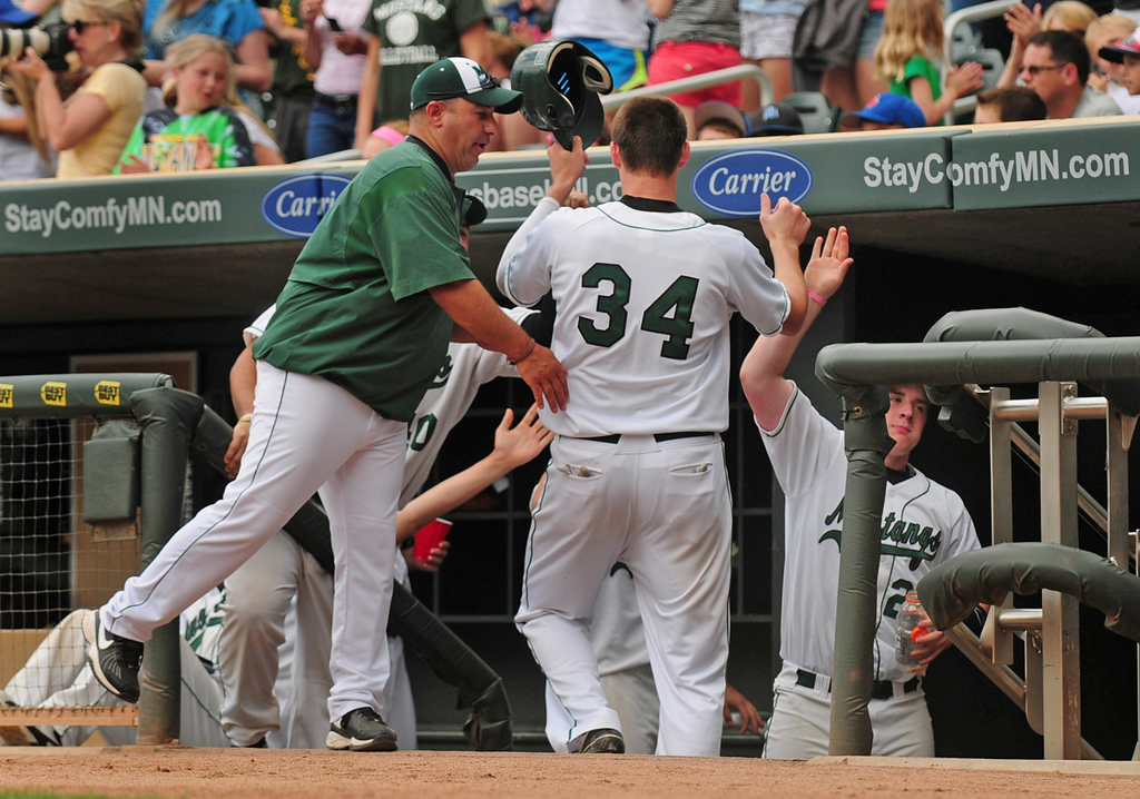 . Mounds View\'s Sam Hentges is congratulated after being driven in on a double by teammate Lars Anderson in the fourth inning. Hentges was 3 for 4 at the plate with a double, triple and single in the Mustangs\' 8-0 win.  (Pioneer Press: Scott Takushi)