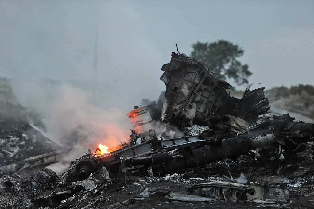 . A picture taken on July 17, 2014 shows flames amongst the wreckages of the malaysian airliner carrying 295 people from Amsterdam to Kuala Lumpur after it crashed, near the town of Shaktarsk, in rebel-held east Ukraine. Pro-Russian rebels fighting central Kiev authorities claimed on Thursday that the Malaysian airline that crashed in Ukraine had been shot down by a Ukrainian jet. The head of Ukraine\'s air traffic control agency said Thursday that the crew of the Malaysia Airlines jet that crashed in the separatist east had reported no problems during flight. AFP PHOTO/DOMINIQUE  FAGET/AFP/Getty Images