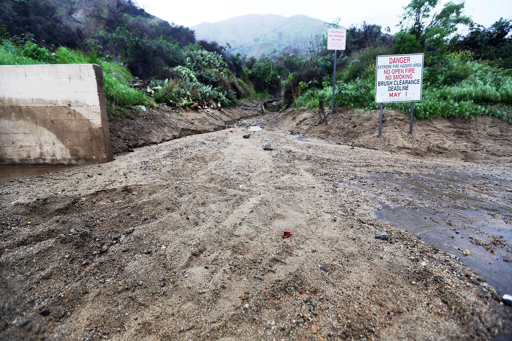 . Mud from earlier storms is seen in a wash above Melcanyon Road in Duarte, Calif., in a threatened area below a San Gabriel Mountains burn area known as the Fish Fire, as a powerful storm moves into Southern California Friday, Feb. 17, 2017. The saturated state faces a new round of wet weather that could trigger flooding and debris flows. (AP Photo/Reed Saxon)