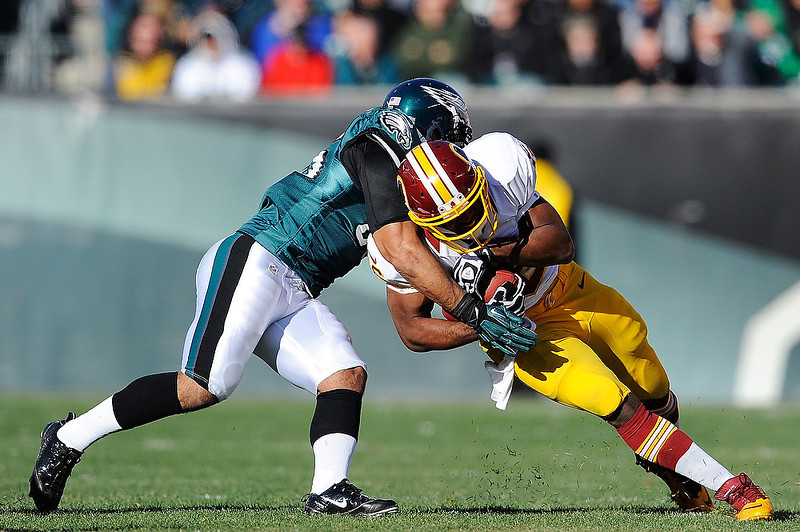 . Alfred Morris #46 of the Washington Redskins is tackled by Mychal Kendricks #95 of the Philadelphia Eagles during a game at Lincoln Financial Field on December 23, 2012 in Philadelphia, Pennsylvania. (Photo by Patrick McDermott/Getty Images)