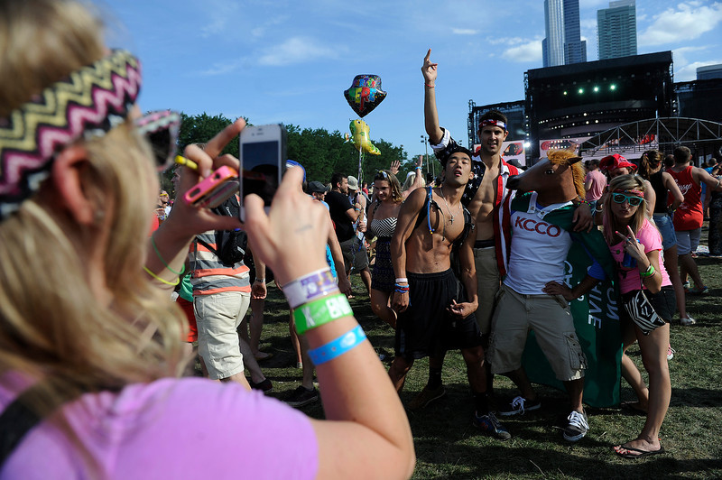 . Fans dance as Baauer performs during Lollapalooza at Grant Park on August 3, 2013 in Chicago, Illinois. (Photo by Seth McConnell/The Denver Post)
