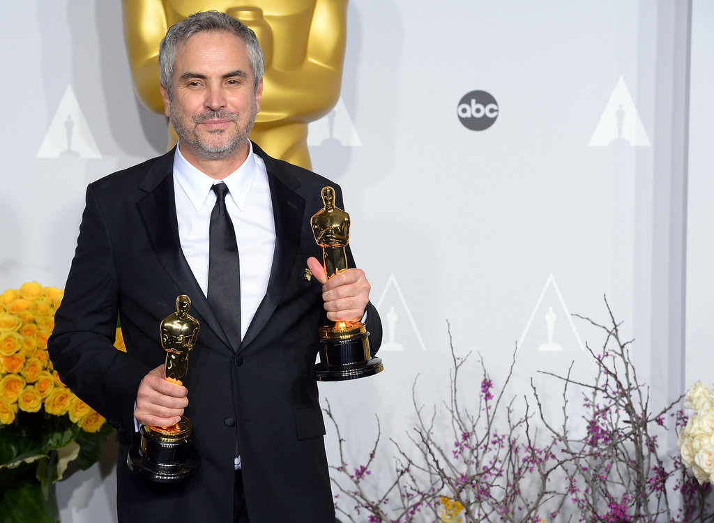 . Alfonso Cuarón accepts the Achievement in Directing award for \'Gravity\' backstage at the 86th Academy Awards at the Dolby Theatre in Hollywood, California on Sunday March 2, 2014 (Photo by David Crane / Los Angeles Daily News)