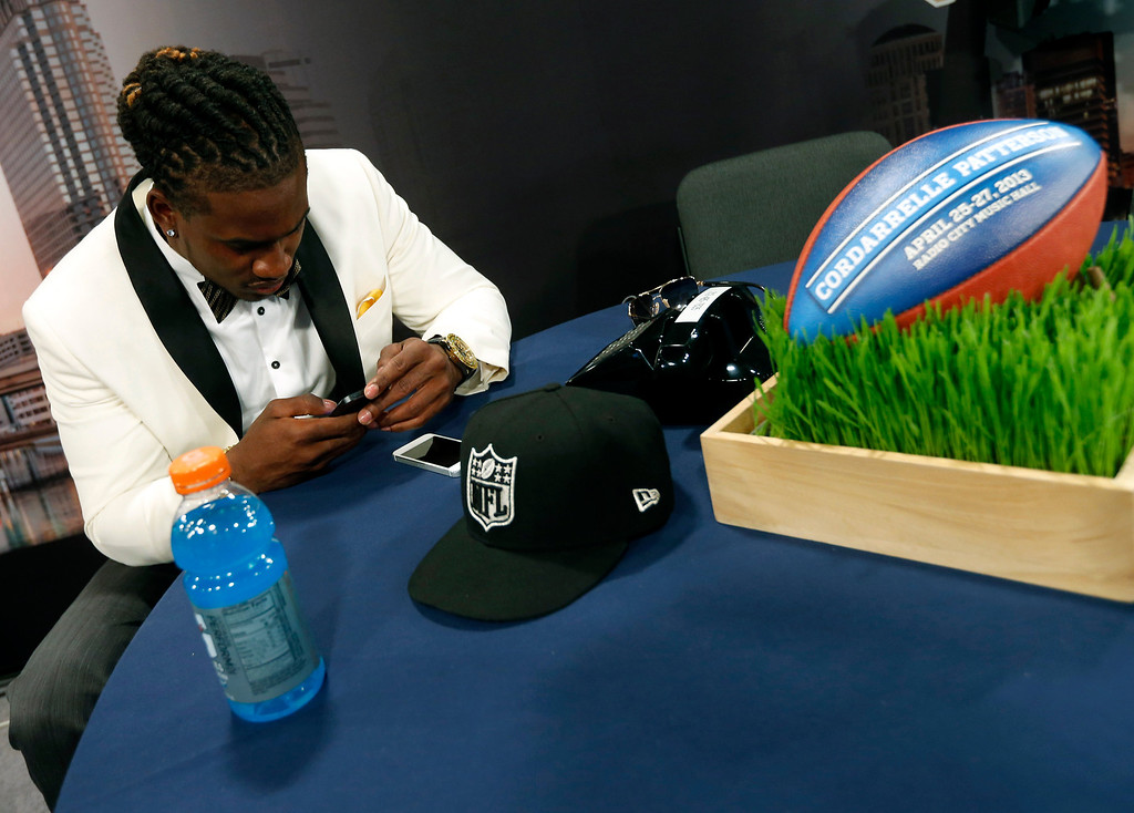 . Wide receiver Cordarrelle Patterson, from Tennessee, checks his cell phone in the green room before the first round of the NFL football draft, Thursday, April 25, 2013 at Radio City Music Hall in New York.  (AP Photo/Jason DeCrow)