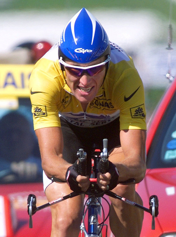 . Overall leader Lance Armstrong of the U.S. strains on his way to win the 19th stage of the Tour de France cycling race, a 57-kilometer individual time trial around the Futuroscope theme park near Poitiers, western France, Saturday, July 24, 1999. (AP Photo/Laurent Rebours)