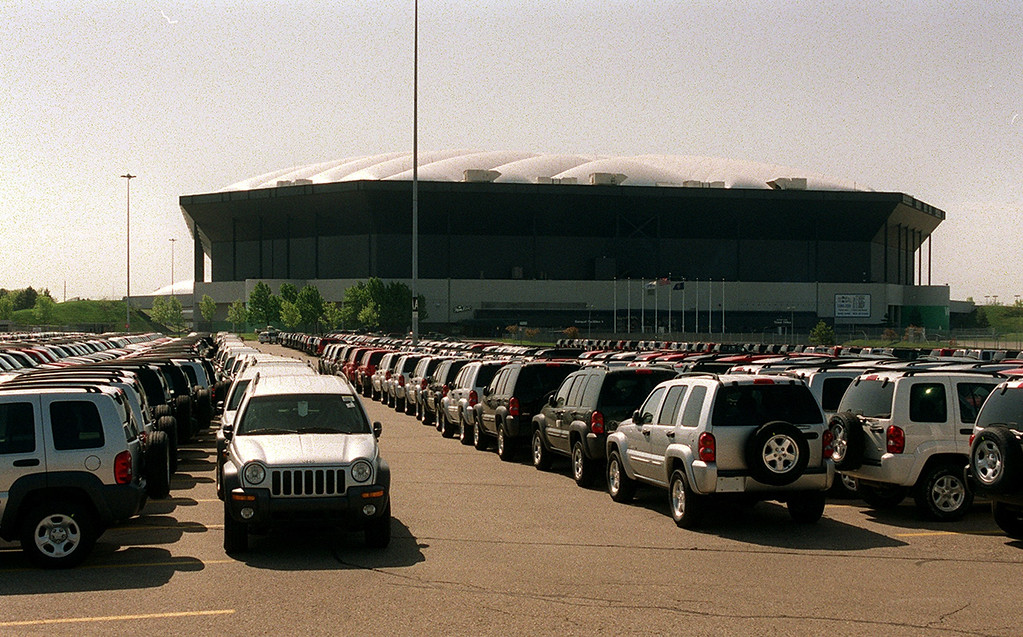 . Jeep Libertys line the northern portion of the Pontiac Silverdome Wednesday.