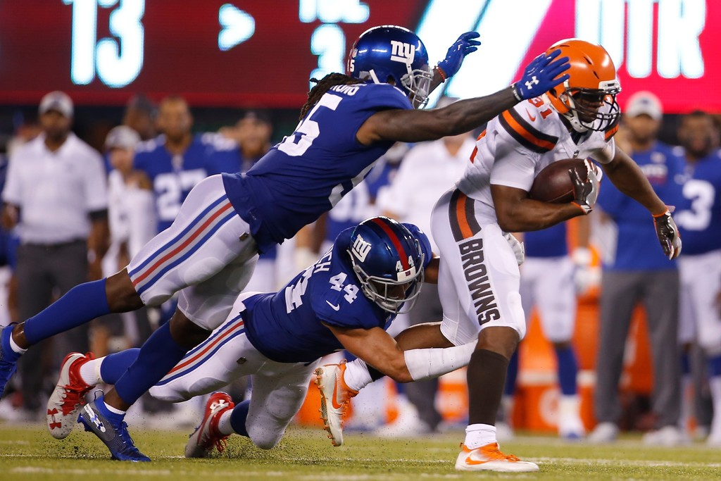 . Cleveland Browns running back Nick Chubb (31) rushes past New York Giants\' Mark Herzlich (44) during the second half of a preseason NFL football game Thursday, Aug. 9, 2018, in East Rutherford, N.J. (AP Photo/Adam Hunger)
