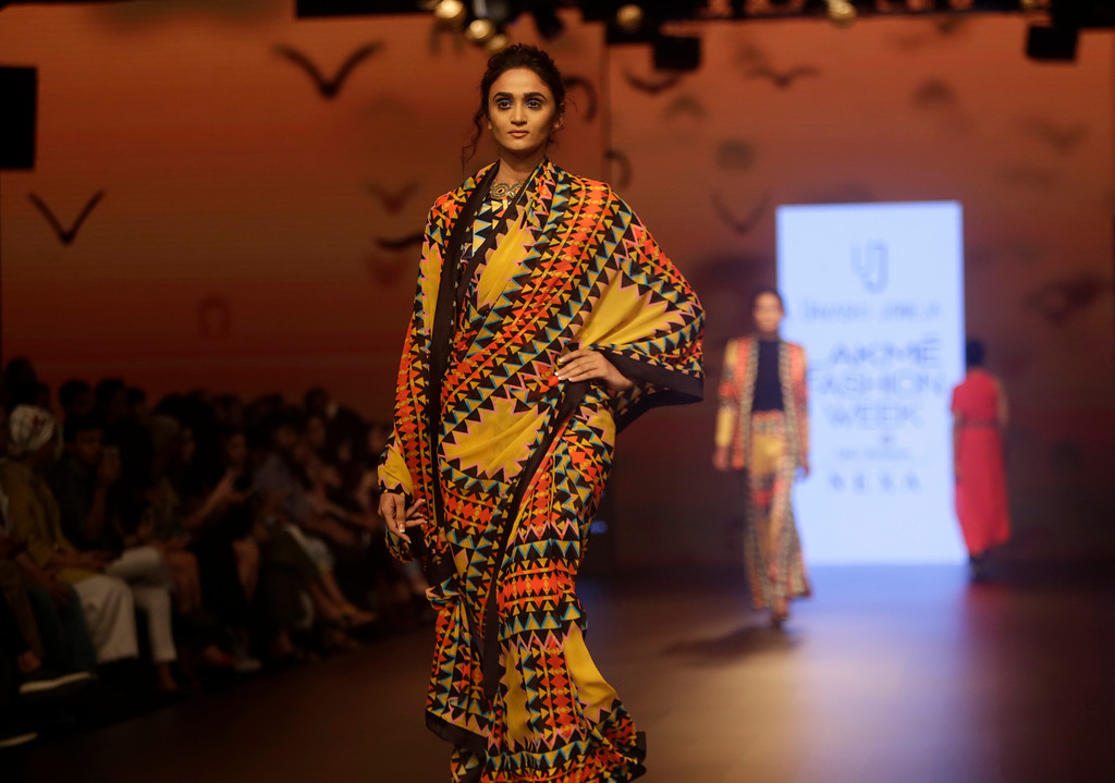 . A model walks the ramp to showcase the creation of designer Urvashi Joneja during the Lakme fashion week winter in Mumbai, India, Wednesday, Aug. 22, 2018. (AP Photo/Rajanish Kakade)