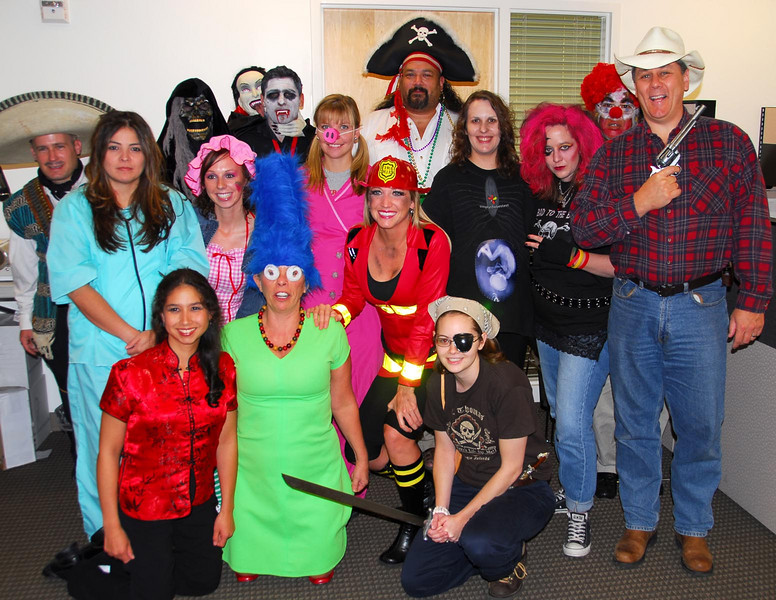 10/31/07 – On Halloween a large number of the employees got dressed up. We couldn't get them all together for a photo, but we pulled together a few. We had a fun day. I'm the chunky cowhand on the right.
