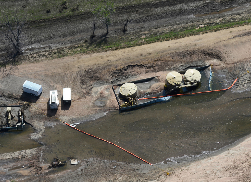 . WELD COUNTY, CO - SEPTEMBER 19: Oil booms spread across a creek from an Anadarko site south of Milliken Colorado Thursday morning, September 19, 2013 as flood waters are starting to recede from last weeks floods. (Photo By Andy Cross/The Denver Post)