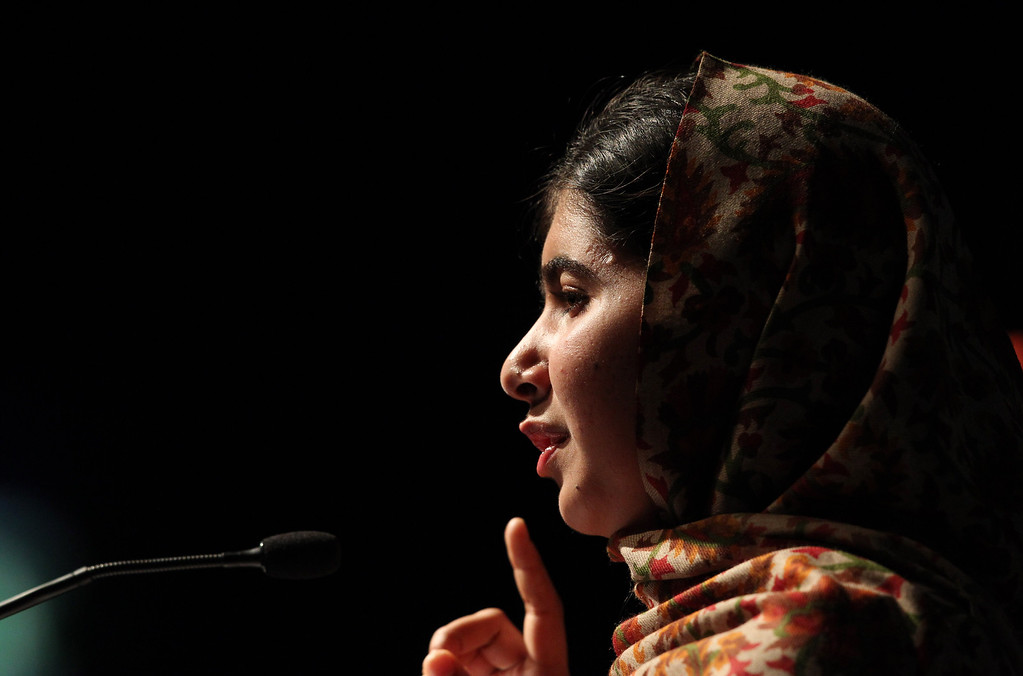. In this photograph taken on September 17, 2013 Pakistani student who was shot in the head by the Pakistani Taliban, Malala Yousafzai addresses the assembly before receiving the Amnesty International Ambassador of Conscience Award for 2013 at the Manison House in Dublin, Ireland.  AFP PHOTO/ PETER MUHLY /AFP/Getty Images