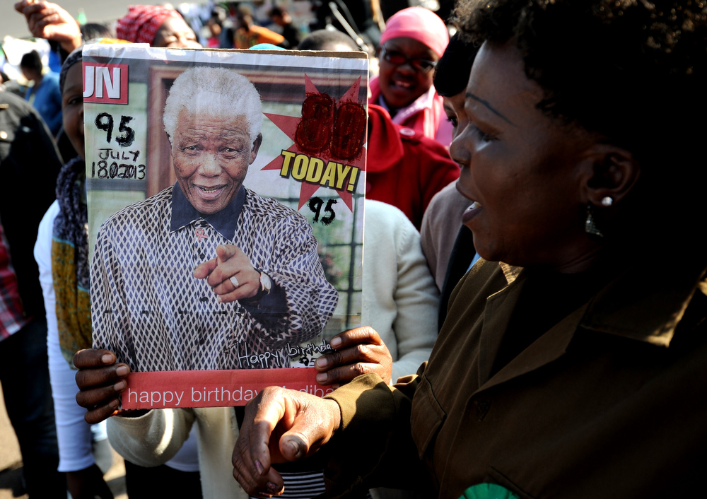 """. A woman sings \""""Happy Birthday\"""" for former South African President Nelson Mandela on July 18, 2013 outside the Medi Clinic Heart Hospital in Pretoria. Mandela\'s health is \""""steadily improving\"""", South Africa\'s presidency said on July 18 as the anti-apartheid legend began spending his 95th birthday in hospital. Children in schools around the country kicked off the celebrations by singing \""""Happy Birthday\"""" to Mandela, on a day that also marked the 15th anniversary of his marriage to third wife Graca Machel.The United Nations declared the Nobel Peace laureate\'s birthday Mandela Day in 2010, but for many this year it takes on extra poignancy.  STEPHANE DE SAKUTIN/AFP/Getty Images"""