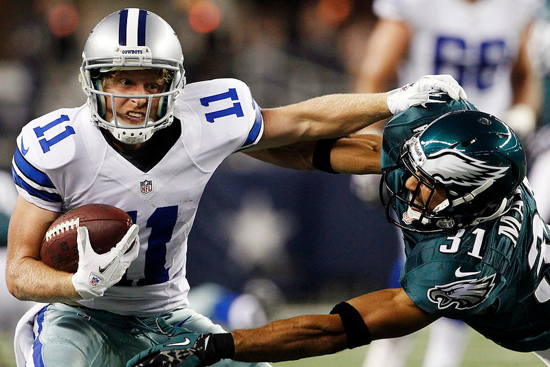 . Dallas Cowboys wide receiver Cole Beasley (11) pushes off Philadelphia Eagles defensive back Curtis Marsh (31) during the first half of an NFL football game, Sunday, Dec. 2, 2012, in Arlington, Texas. (AP Photo/Tony Gutierrez)