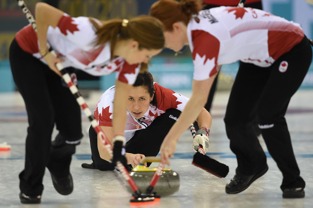 . Canada\'s Jill Officer throws the stone during the Women\'s Curling Round Robin Session 6 match Canada vs Switzerland at the Ice Cube Curling Center during the Sochi Winter Olympics on February 13, 2014. DAMIEN MEYER/AFP/Getty Images