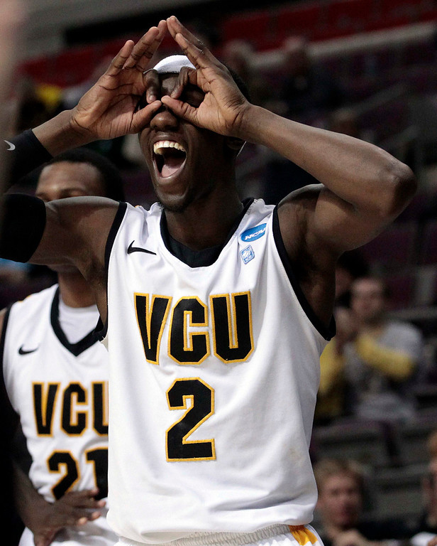 . VCU Rams Briante Weber celebrates a three point shot by his teammate against the Akron Zips during the second half of their second round NCAA tournament basketball game in Auburn Hills, Michigan March 21, 2013. REUTERS/Jeff Kowalsky