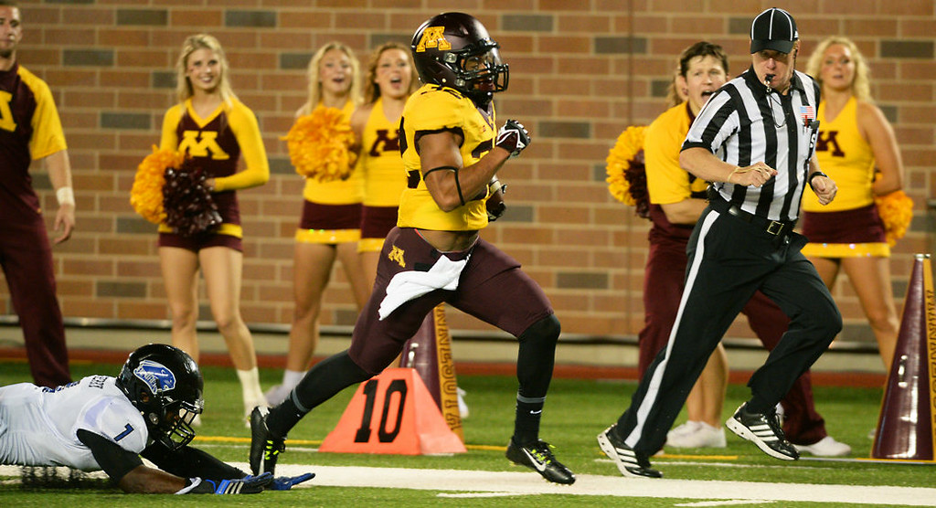 . Minnesota running back Berkley Edwards beats the last Eastern Illinois defender, cornerback Jeremy Joseph, on his way to a 42-yard touchdown run in the fourth quarter. (Pioneer Press: John Autey)