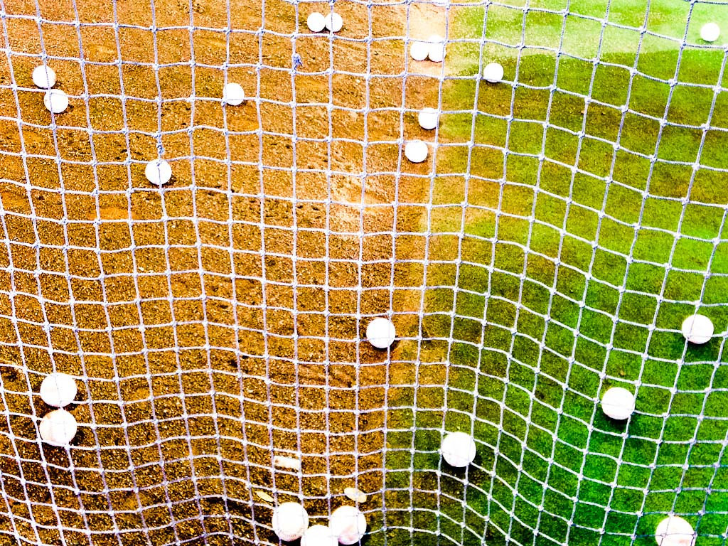 . Foul balls litter the ground inside the batting cage. (Pioneer Press: Ben Garvin)