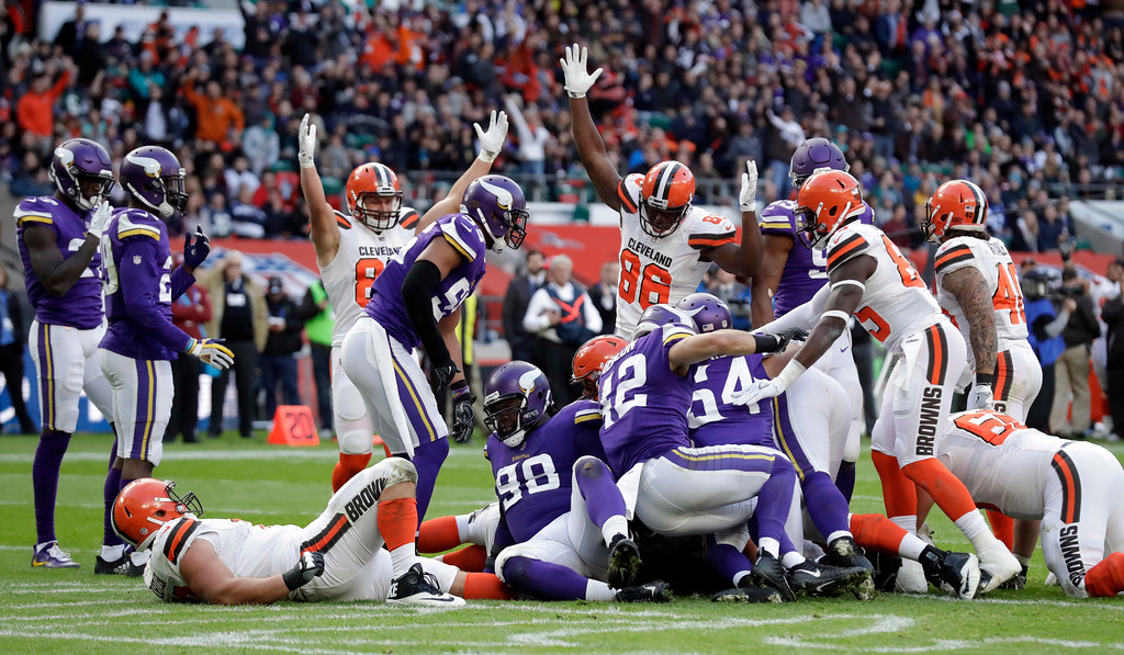 . Cleveland Browns players celebrate after quarterback DeShone Kizer (7) scored a touchdown during the first half of an NFL football game against Minnesota Vikings at Twickenham Stadium in London, Sunday Oct. 29, 2017. (AP Photo/Matt Dunham)
